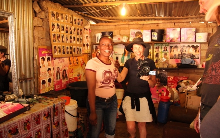 Inside an African Hair Dressing Salon - Ribola Art Route - Ronel and Shop Manager having fun with camera - looking at the photographer