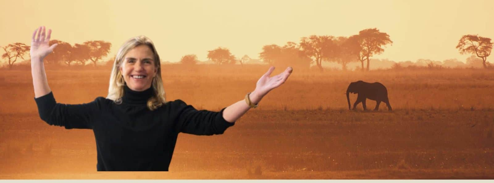 Picture of Alexandra with Arms open towards sky - with vast open savannah plain with elephant in background
