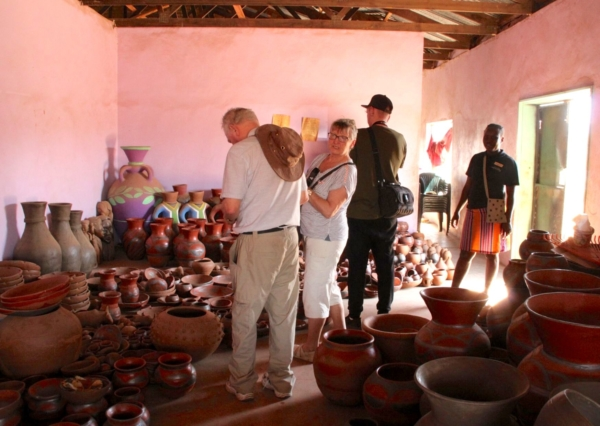 Alexandra's Africa Guests inside Mukondeni Pottery Shop - selecting a few curios to take home