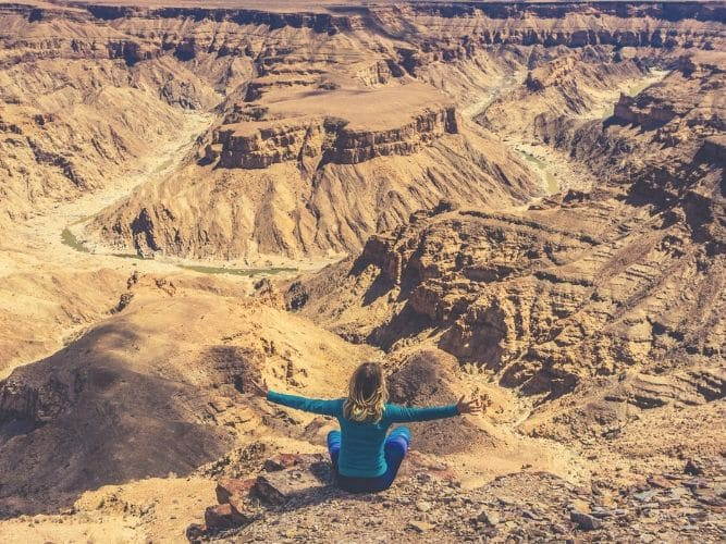 On A Guided Camping Safari - Guest looking out over the canyon - enjoying the view out over the Fish River Canyon