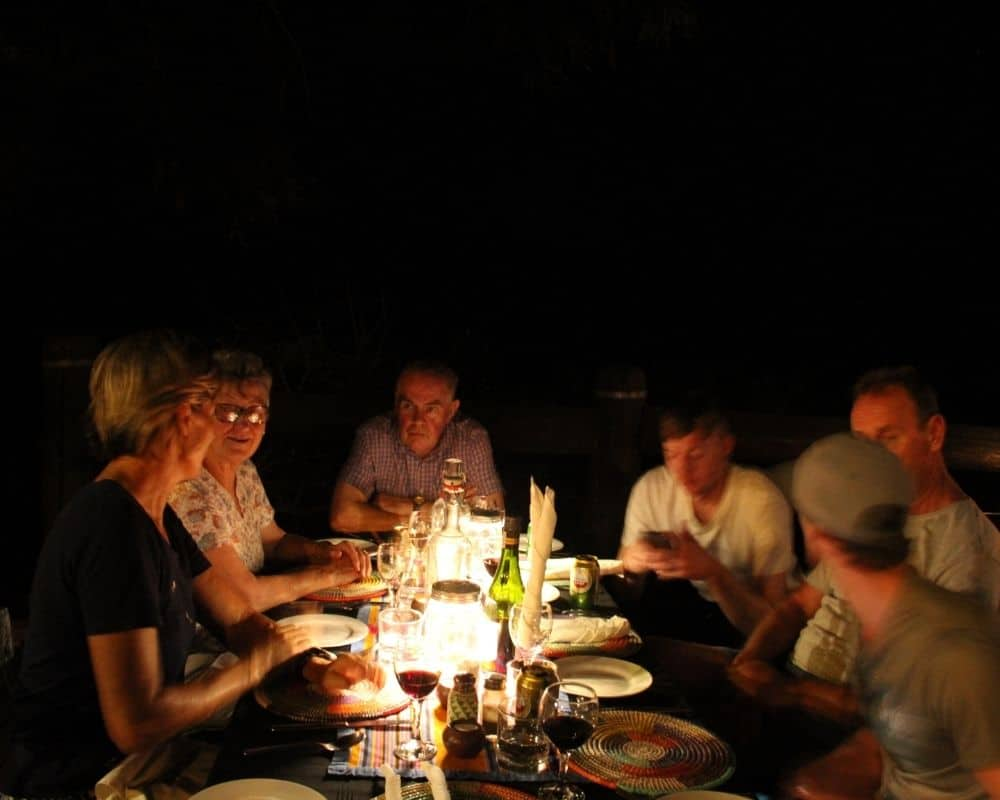 Guests enjoying a candle lit dinner