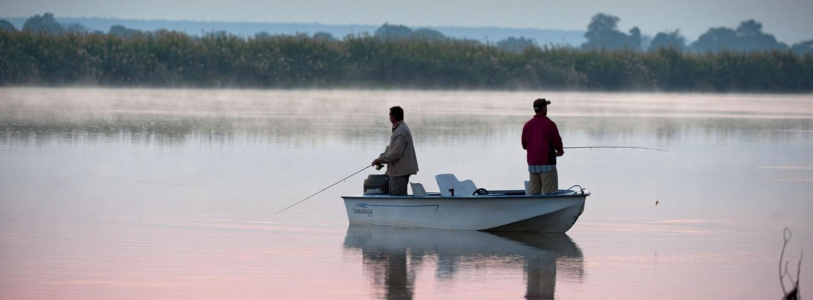 Chobe Fishing - two men in a small boat Tiger Fishing in the Chobe River