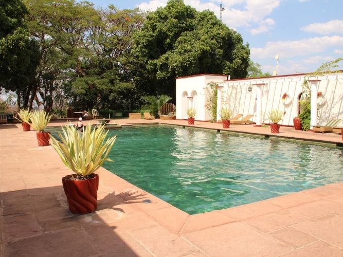 The Swimming pool at Victoria Falls hotel - with potted aloes around the edge of the pool