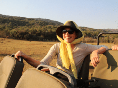 Alexandra's Africa guest enjoying a game drive on a Hosted Safari