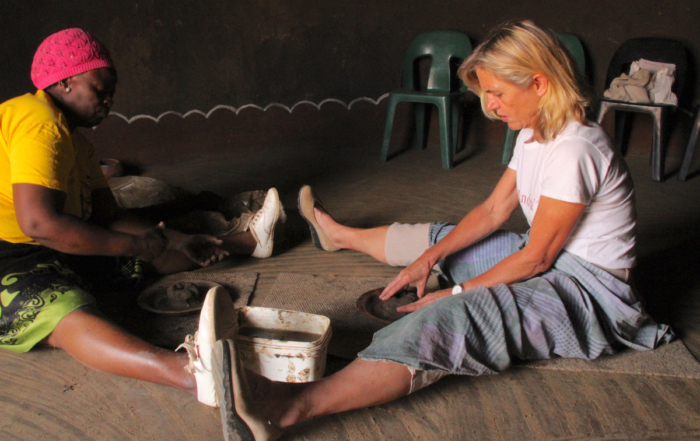 Alexandra being taught how to make Venda clay pots at Mukondeni Village Pottery