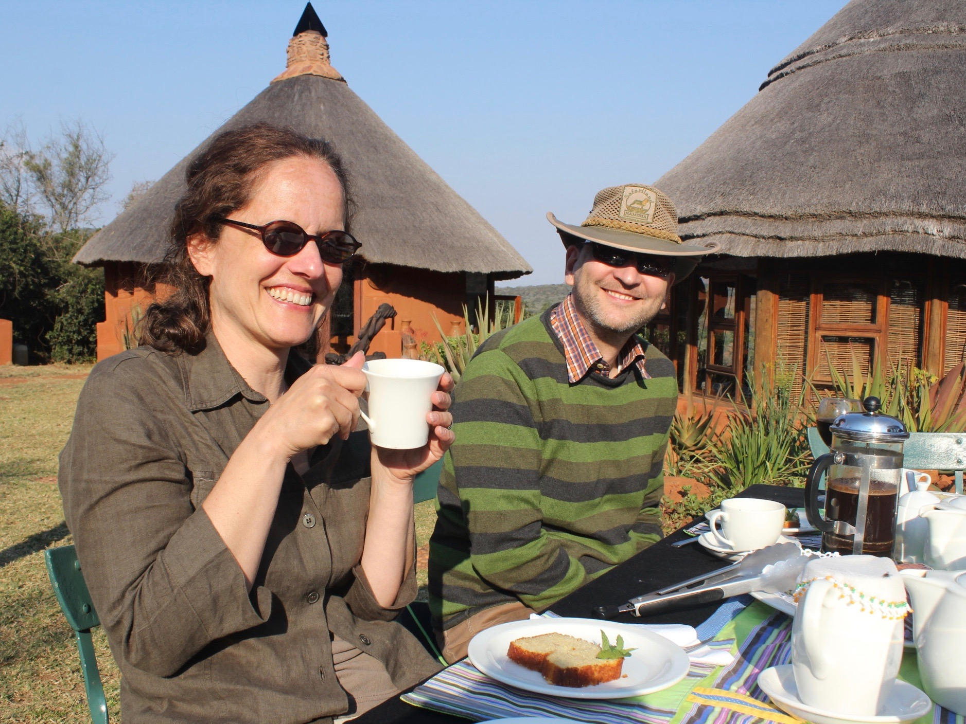 Guests enjoying tea and cake in the grounds of our Venda Village Eco Lodge