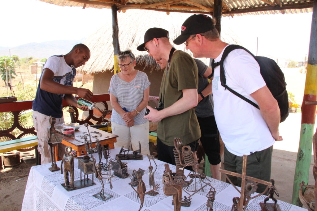 Pilato demonstrates to Alexandra's Africa guests how he makes his earrings from scrap metal