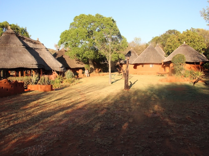 The setting sun on our eco-lodge village casts long shadows on the chique huts