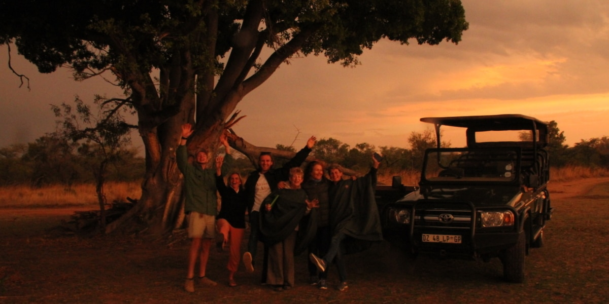 Guests enjoying a spectacular sunset on a hosted safari