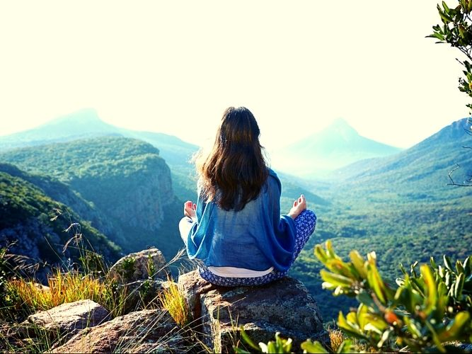 Luvhondo Guest meditating and looking out over mountain scenery
