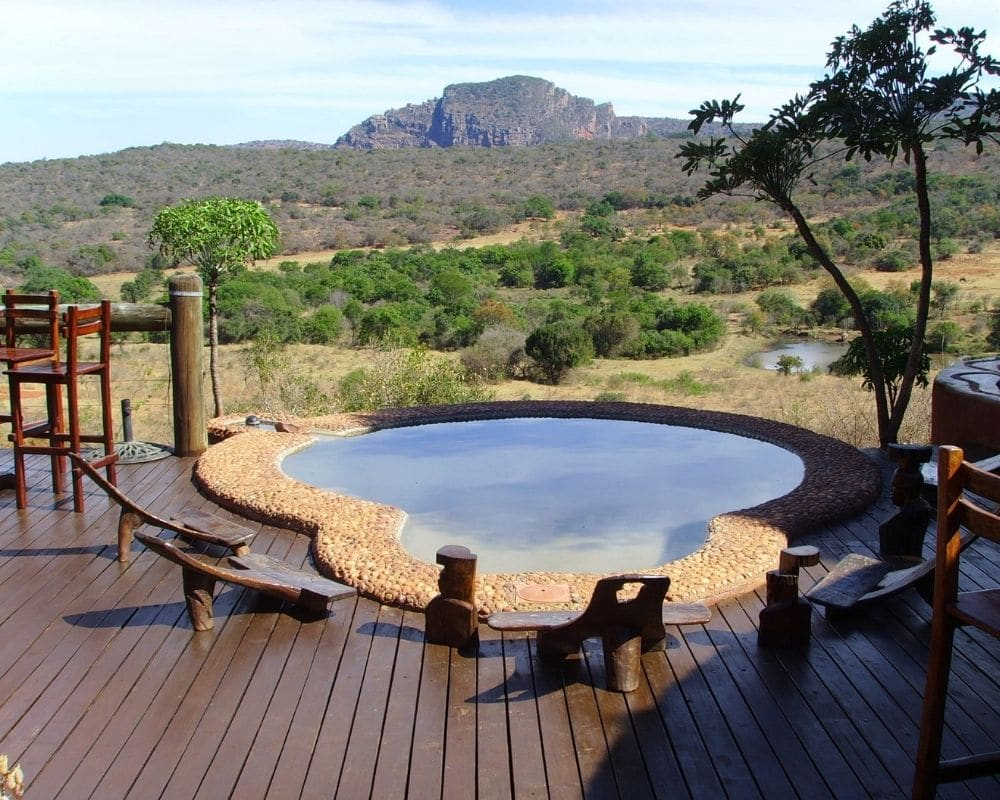 Views overlooking the valley with mountains in the distance from the patio of one of our lodges with plunge pool in foreground