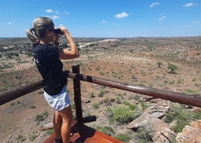 Woman standing on viewing platform overlooking Limpopo River Valley