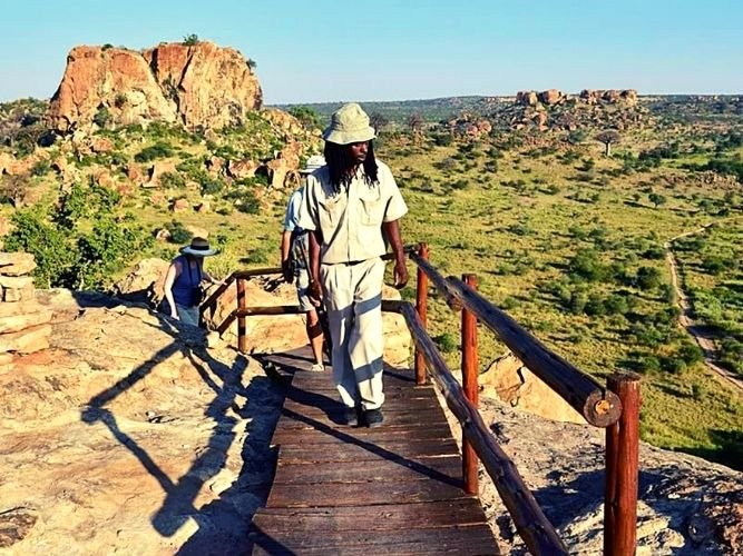 Trail leading group of visitors at Mapungubwe