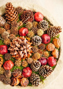 Potpourri of fir cones and seeds in a wooden bowl on table
