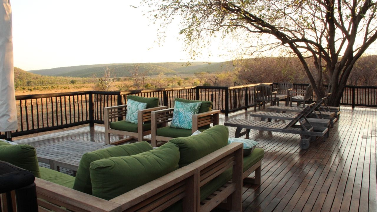 Sun loungers on the wooden terrace of our Safari Lodge with views out over the bushveld