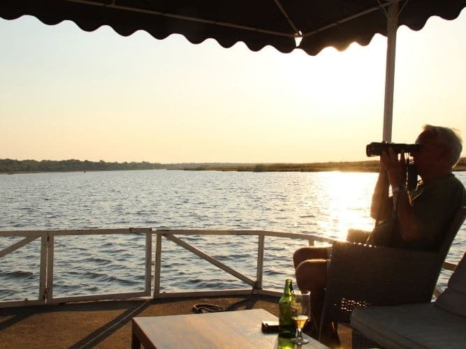 Alexandra's Africa guest enjoying sundowner cruise on the Chobe - Game Viewing