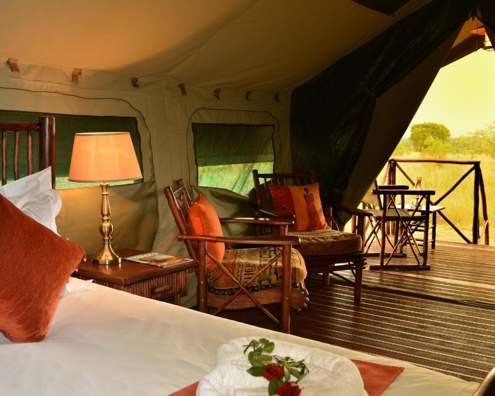 Tented bedroom with sunset view