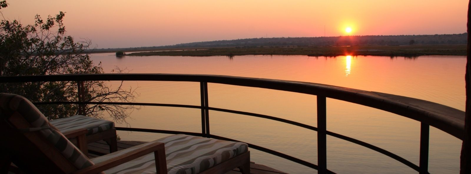 Enjoying a Chobe River Sunset - view from guests balcony over the Chobe River enjoying the sunset in the distance