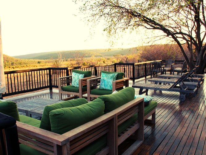 The extensive view out over the bush veld from the main decking area at the final lodge of our Safari